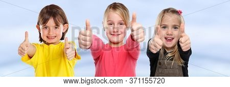 Group Of Children Kids Smiling Young Little Girls Success Thumbs Up Positive