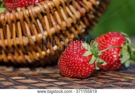 Strawberries On Wooden Table. Strawberries On Gardens Table
