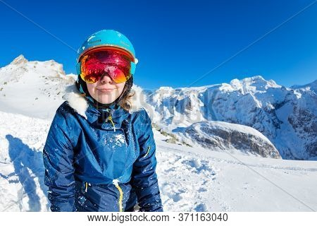 Close Portrait Of Happy Teen Girl Smiling Wearing Cute Winter Ski Outfit Glasses And Helmet In Snow