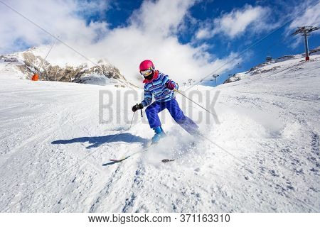 Action High Speed Motion Of The Girl Ski Downhill In The Mountains