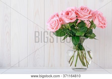Bouquet Of Pink Roses In A Glass Vase On A Light Wooden Board, Floral Background. Festive Frame, Gif
