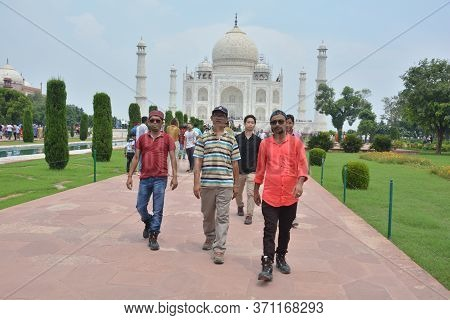 Agra, Uttar Pradesh, India, 9th August, 2018:   Indian Tourist Posing For Photograph Before The Famo