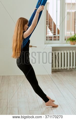 Stretching Workout. Healthy Lifestyle. Young Beautiful Girl In Black Uniform Is Doing Stretching Exe