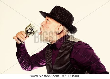 Bearded Old Guy Hold Wineglass With Spider Inside. Extreme Lifestyle. Exotic Food. Cocktail With Rea