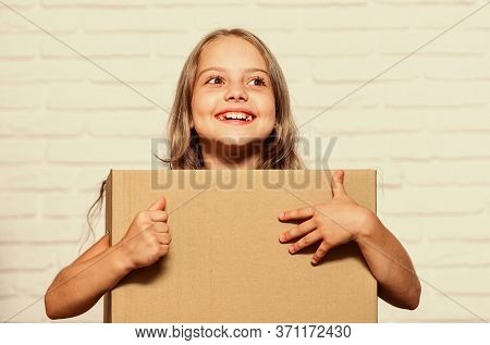 Rent House. Real Estate. Make Moving Easier. Girl Small Child Carry Cardboard Box. Packaging Things.