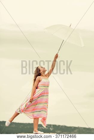 Carefree Childhood. Small Girl With Umbrella. Rainy Weather. Fall Mood. Autumn Weather Forecast. Aut