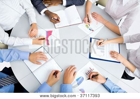 Image of business people hands working at meeting poster