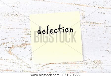 Yellow Sticky Note On Wooden Wall With Handwritten Inscription Defection