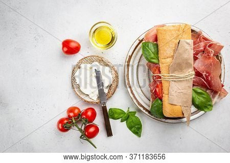 Spanish Breakfast, Top View. Toast Or Sandwich With Jamon, Cheese And Tomato Sauce