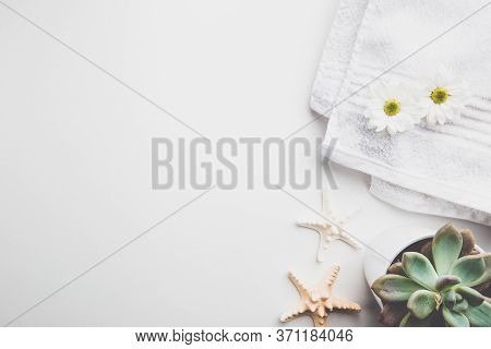 Spa Wellness Flat Lay. Spa Towel With Flowers, Candle And Seastares Over White Background, Top View.