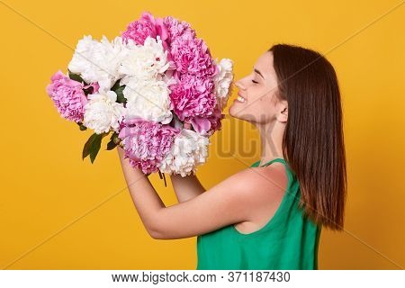 Happy Female Wearing Green Attire Holding And Smelling White And Pink Peonies Flowers, Woman Express