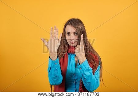 Showing Six 6 Fingers Hand Gesture, Show The Number Three With Hands, Pointing Up Arm While Smiling