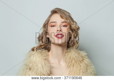 Portrait Of Nice Woman In Eco Friendly Faux Fur Coat On White Background