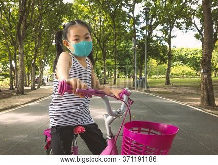 Asian Little Girl Wearing Face Protection