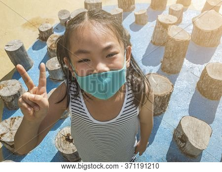 Little Girl In Outdoors Activity