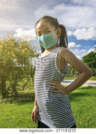 Little Girl Posing In Park