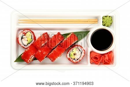 Close Up Take Away Set Of Boston Or California Sushi Rolls With Red Tobiko Caviar And Crab Meat In D