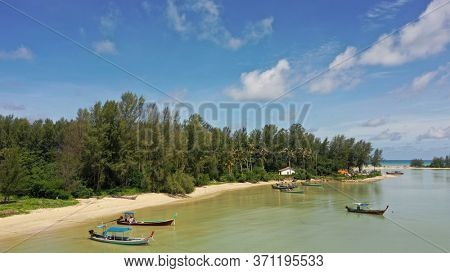 Fishing boats and sandy beach and sea in Thailand