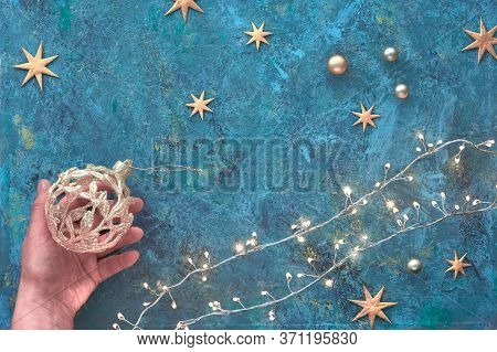 Christmas Or New Year Flat Lay Background On Dark Tile Textured Board. Top View Flat Lay On Xmas Gar