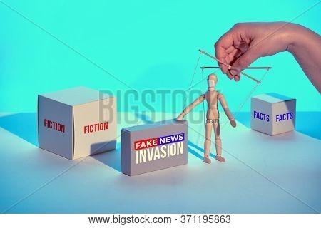 Box With Text Fake News Invastion . Infodemics Of Fake News And Rumors About Covid-19. Sinister Hand