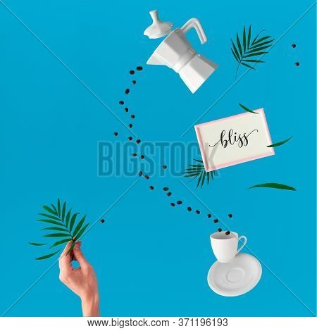 Trendy Levitation. Flying Line Of Coffee Beans Between Ceramic Coffee Maker And Espresso Cup. Female