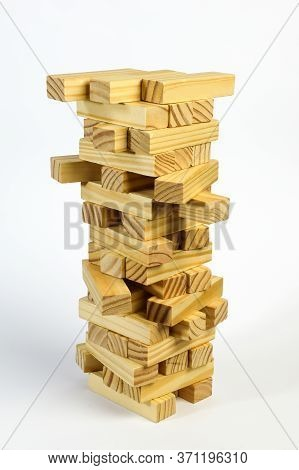 In The Stack Are Many Wooden Cubes Stacked On Top Of Each Other. Isolated On A White Background.