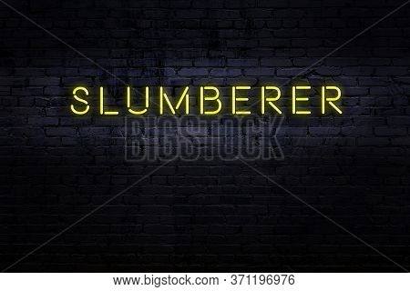 Neon Sign On Brick Wall At Night. Inscription Slumberer