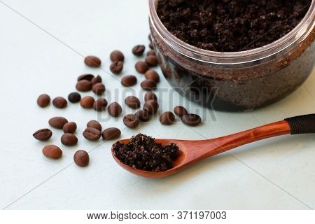 Wooden Spoon With Coffee Scrub As Homemade Facial And Body Exfoliation Treatment. Homemade Cosmetics