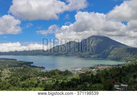 Aerial View Over Lake Batur To The Traditional Village Of Trunyan. In This Village, The Locals Bury