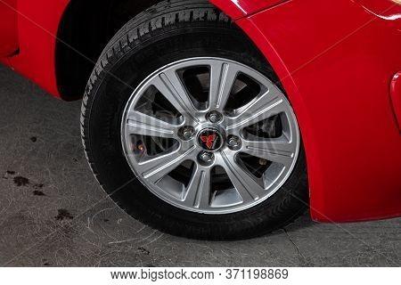 Novosibirsk/ Russia - June 03, 2020: Mitsubishi Colt, Car Wheel On Gray  Car - Close Up