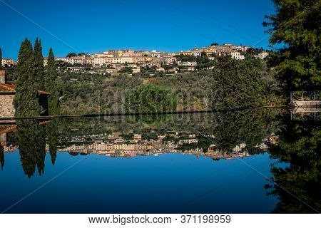 Reflection Of Landscape Of Castagneto Carducci, In The Heart Of The Livorno Maremma, In The Center O