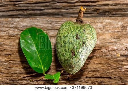 Atemoia Fruit And Leaf (annona Cherimola Mill X Annona Squamosa L.) On Aged Wooden Background