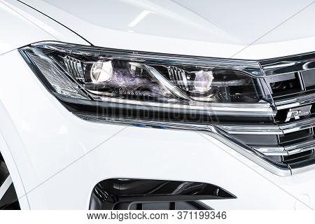 Novosibirsk/ Russia - March 15, 2020: Volkswagen Touareg, Glowing Headlight Of A Modern Car Close-up