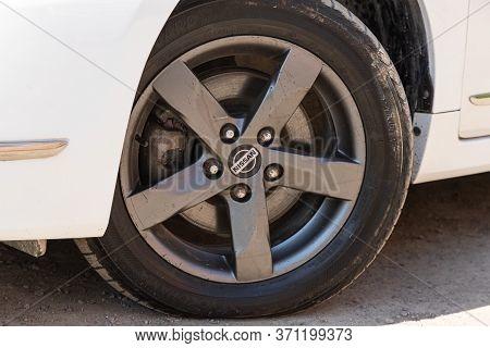 Novosibirsk/ Russia - May 22, 2020: Nissan Teana, Car Wheel On Gray  Car - Close Up