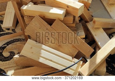 Lumber. Firewood. Building Materials For Construction On The Floor. Sawn Wooden Boards, Bars On A Sa
