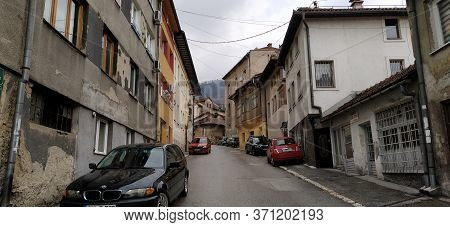 Sarajevo, Bosnia- March 8, 2020: Tourists Are Visiting Sebilj, Sarajevo Streets, Old Buildings, Tran