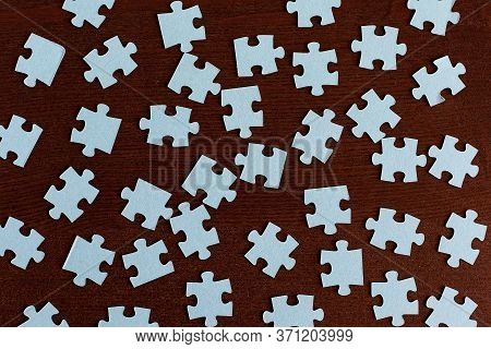 Incomplete Puzzles. Jigsaw Puzzle. A Lot Of Puzzles. White Puzzles. White Background. Texture Of Puz