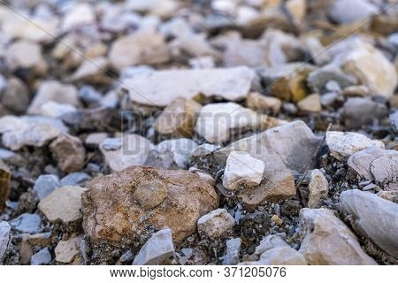 White-gray Gravel And Rubble Close-up. Rubble Stones, Photos With Low Depth Of Field. High Quality P