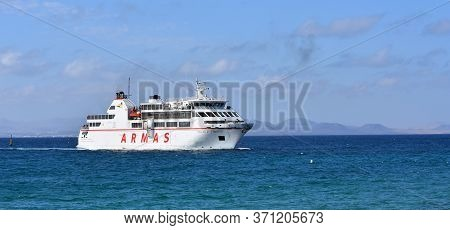 Planya Blanca, Lanzarote, Spain: April 02, 2019: Canary Island Ferry Sails From Playa Blanca Lanzaro