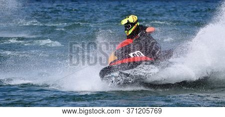 Wyboston, Bedfordshire, England -  May  12, 2019: Jet Ski  Race Competitor Cornering At Speed Creati