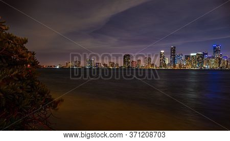 Night Ocean Near Miami. Miami, Florida Skyline And Bay At Sunset Seen. View Of Miami At Sunset, Usa.