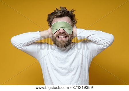 Nervous Man In A Sleeping Mask Covered Ears With Hands So As Not To Hear The Noise, He Is Annoyed An