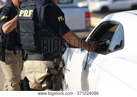 Salvador, Bahia / Brazil - October 11, 2018: Federal Highway Police (prf) Officer Approaches The Dri