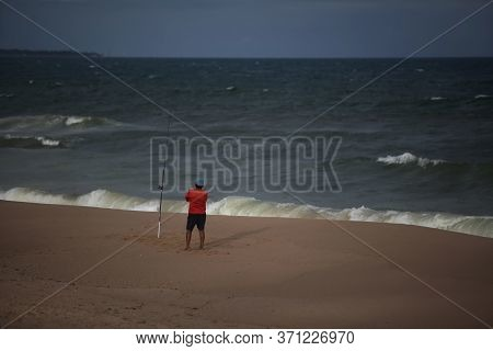 Salvador, Bahia / Brazil - October 4, 2017: Fisherman Is Seen On Empty Beach In The Jardim De Alah R