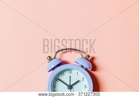Simply Minimal Design Ringing Twin Bell Vintage Classic Alarm Clock Isolated On Pink Pastel Backgrou