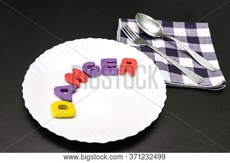 Colorful Letters With Word Danger On Plate With Fork And Knife, Food Additive And Unhealthy Food Con