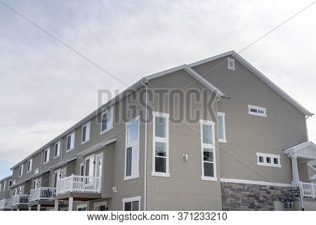 Townhouses Exterior With Small Balconies At The Facade In South Jordan Utah