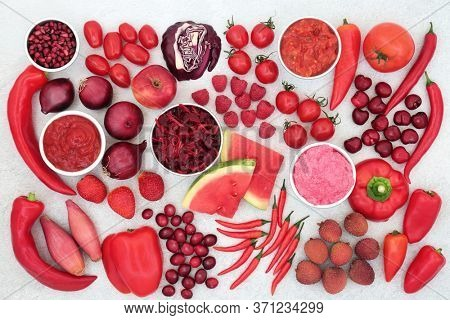 Vegan health food  high in anthocyanins of red and purple fruit, vegetables, sauces, salad & dips. Foods also very high in vitamins, minerals, antioxidants & dietary fibre. Immune boosting concept.