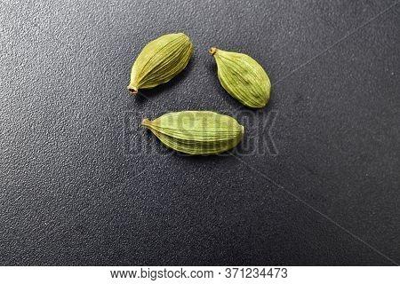 Macro Images Of Cardamom On Black Textured Background, Close Up Of Cardamon