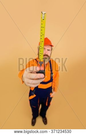 Builder With Measure Tape. Selective Focus. Construction Worker. Worker Use Tape Measure. Builder Eq